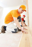 Parquet workers at flooring work Stock Images