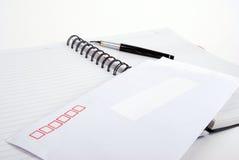 Parquez et enveloppez sur le cahier Photographie stock libre de droits