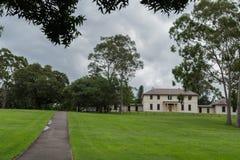Government House in Domain park, Parramatta Australia. Parramatta, Australia - March 24, 2017: Beige, two-level colonial Government House in Domain park under Stock Photos