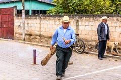 Local man ignites rocket in street, Guatemala Royalty Free Stock Photos