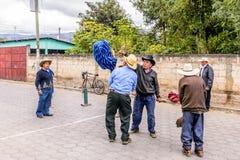 Local men ignite rocket in street, Guatemala Royalty Free Stock Photo