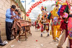 Marimba musicians & traditional folk dancers in street, Guatemal Royalty Free Stock Images