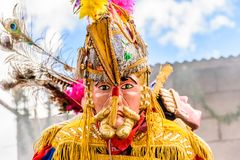 Traditional folk dancer in Spanish conquistador mask & costume,. Parramos, Guatemala - December 29, 2016: Traditional folk dancer in Spanish conquistador mask & royalty free stock images