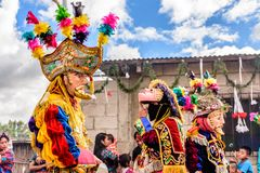 Traditional folk dancers in street, Guatemala Royalty Free Stock Images