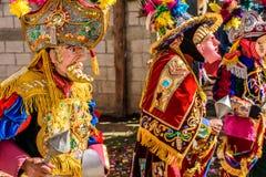 Traditional folk dancers in street, Guatemala Stock Photos