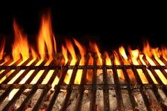 Parrilla aislada en el fondo negro, primer del fuego de la barbacoa Foto de archivo