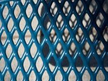 Parrilla azul del metal con shadows-5022225 Fotografía de archivo