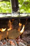 Parrilla con la placa caliente y el alimento Fotos de archivo