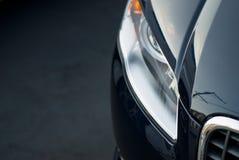 Parrilla y faro negros del coche Foto de archivo libre de regalías