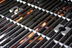 Parrilla y fuego calientes Imagen de archivo libre de regalías