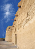 Parrot beak openings to defend from invader. Arad Fort is a 15th century fort in Arad, Bahrain Royalty Free Stock Images