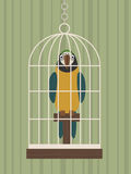 Parrot in cage Stock Photo