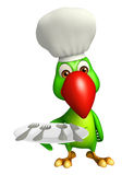 Parrot cartoon character with dinner plate and chef hat Stock Photography