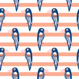 Parrot pattern seamless bird vector. Blue toucans on coral red striped background vector illustration