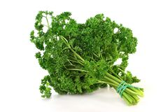 Parsley. A bunch of parsley on a white background Stock Photo