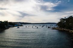 Parsley bay beautiful view with dark tone water ocean texture, the image shows the boat port in the bay with a cloudy day. A Parsley bay beautiful view with royalty free stock photography
