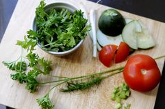Parsley bowl and vegetables Stock Images
