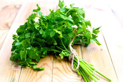 Parsley. Bunch of ripe parsley on wood background stock images