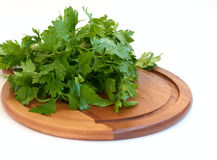 Parsley on cutting board. Green parsley on cutting board isolated on white Royalty Free Stock Image