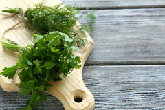 Parsley and dill on a cutting board Stock Photo