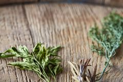 Parsley and dill on wooden background, top view, close-up, selective focus. Some copy space. Natural organic seasoning. Tasty mediterranian cuisine ingredients Royalty Free Stock Photo