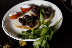 Parsley And Garnish. With olives laid on the plate, closeup angled shot royalty free stock image