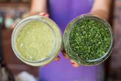 Parsley and ground parsley. In jars royalty free stock image