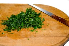 Parsley and a knife Stock Photography