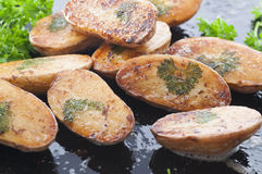 Parsley Leaf Potato. Homemade parsley leaf potato baked in the oven with melted butter and salt royalty free stock photos
