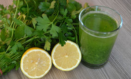 Parsley and lemon juice to oil calore Royalty Free Stock Photography