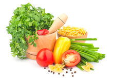 Parsley in mortar and pasta & spices Royalty Free Stock Photos