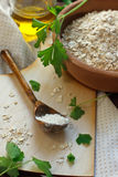 Parsley, olive oil and oat flour. On wooden background Royalty Free Stock Photos