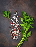 Parsley, salt and pepper. Culinary background. Parsley, salt and pepper. Herbs and spices. Culinary background. Top  view Royalty Free Stock Image