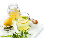 Parsley tea with lemon and honey. On white royalty free stock image