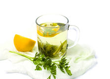 Parsley tea with lemon and lime. On white stock photos