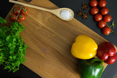Parsley tomatoes and red green yellow peppers. Parsley, tomatoes, and peppers on clean wood backgorund Royalty Free Stock Images