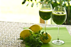 Parsley vegetable drink. A healthy vegetable parsley drink in glass. Food still life photo royalty free stock photography