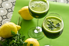 Parsley vegetable drink. A healthy vegetable parsley drink in glass. Food still life photo stock images