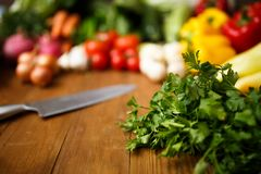 Parsley with vegetables. On table Royalty Free Stock Images
