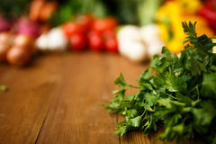 Parsley with vegetables. On wooden Stock Image