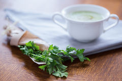 Parsley and white cup Royalty Free Stock Photography