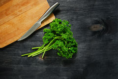 Parsley on a wooden background Stock Photos