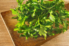 Parsley on a wooden board. Fresh parsley on a wooden board Stock Photos