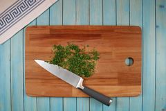 Parsley on a wooden board for cutting vegetables stock photos
