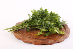 Parsley on a wooden plate Stock Photos