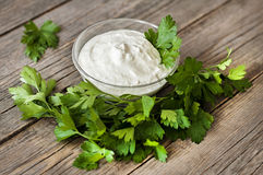 Parsley and yogurt in a glass bowl Stock Photo