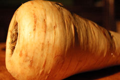 Parsnip. On a wooden chopping board Royalty Free Stock Images