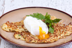 Parsnip pancakes with pouched eggs. Tasty parsnip pancakes with pouched egg Stock Images