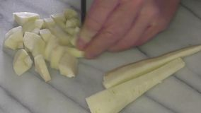 Parsnips being chopped and sliced stock footage