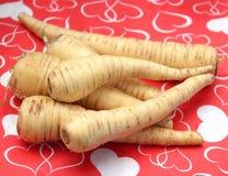 Parsnips. A bundle of fresh, raw, brown parsnips Stock Photo